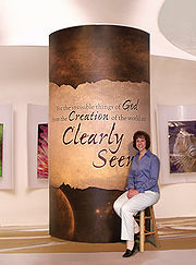 Georgia Purdom in front of a display at the Creation Museum in Kentucky.