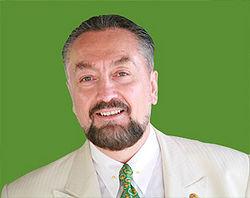 Adnan Oktar Green Portrait Shot.jpg